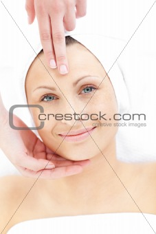 Cute woman receiveing a head massage