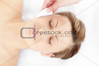 Positive young woman receiving a beauty treatment