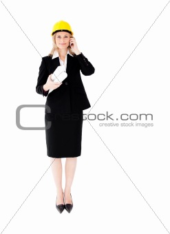 Assertive female architecture talking on phone wearing a hat