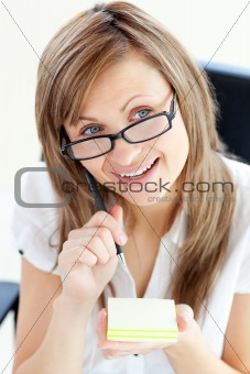 Glowing businesswoman taking notes on her notepad