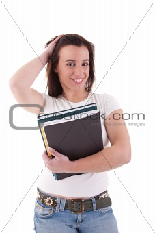 female student smiling and holding notebooks
