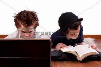 children playing computer and reading a book