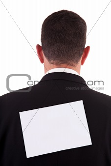 back of businessman, with a paper