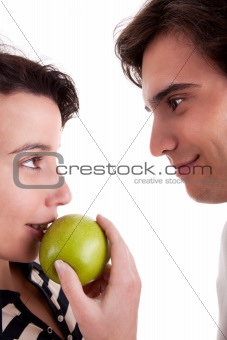 Woman seducing a man eating an apple