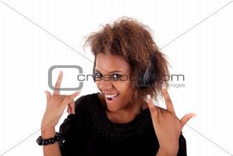 beautiful black woman listening music in headphones