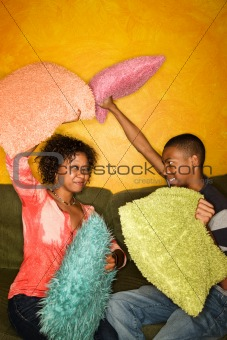 African-American having pillow fight