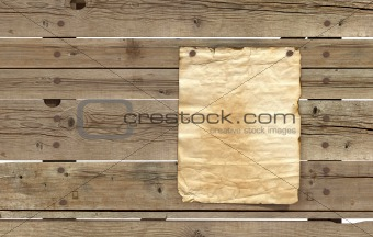 old paper on wooden planks