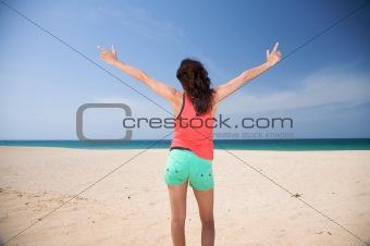 green bottom woman at the beach