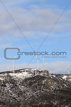 aerogenerator windmills on snow mountain