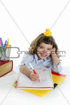 little girl happy student on desk writing