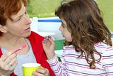 mother and daughter eating ice cream talking