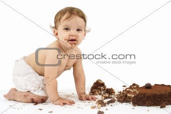 Baby and birthday cake