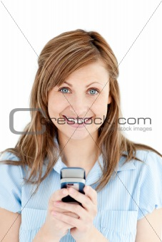 Positive businesswoman texting smiling at the camera