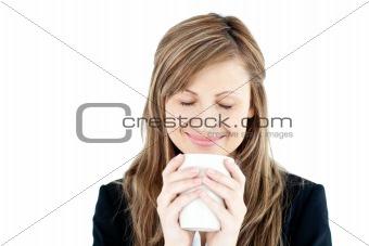 Beautiful businesswoman enjoying her coffee