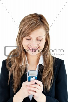 Bright blond businesswoman writing a message on her cellphone