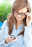 Glowing businesswoman sending a text