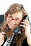 Ambitious businesswoman talking on phone smiling at the camera