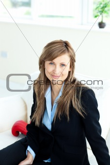 Attractive caucasian businesswoman sitting on a sofa