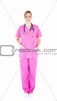 Positive young female surgeon wearing scrubs