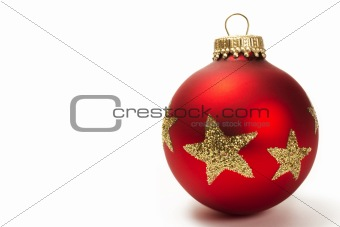 red dull christmas ball with golden glitter stars