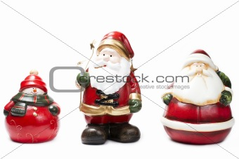 three christmas figurines