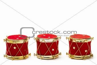 three christmas ball ornaments in drum shape