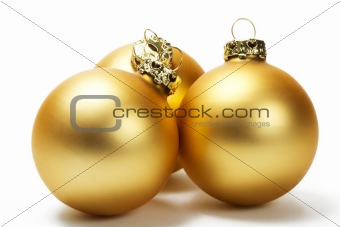 three golden dull christmas balls
