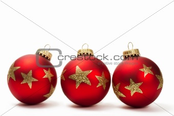 three red dull christmas balls with golden glitter stars