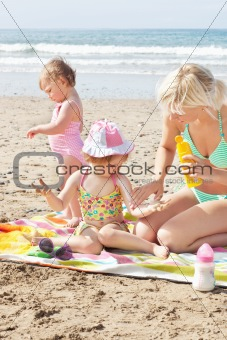 Positive caucasian family at the beach