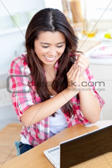 attractive asian woman working on her laptop