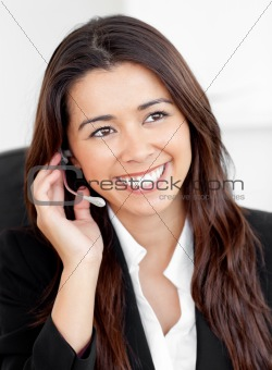 Portrait of an attractive asian businesswoman talking on phone w