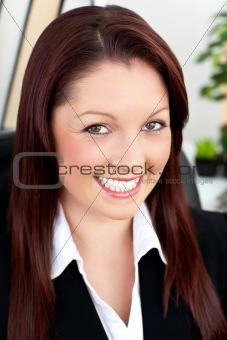 Charming young businesswoman smiling at the camera
