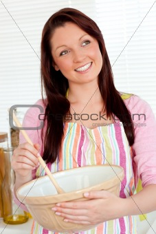 Positive woman cooking at home