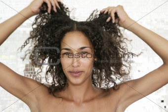 Portrait of female playing with her hair