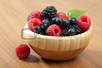 fresh berries in wood bowl