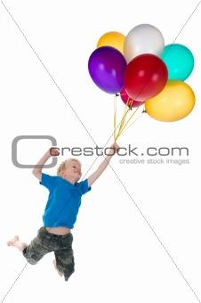 Boy Flying Behind Balloons