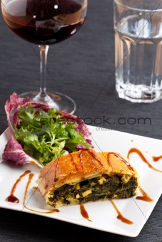 slice of a spinach strudel on a plate
