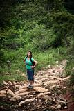 Female hiker on a rugged rustic trail in Costa Rica
