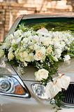 Flower bouquet on wedding car