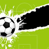Soccer ball on torn paper