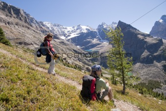 two hikers in canadian rockies