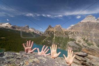 hands up in mountains