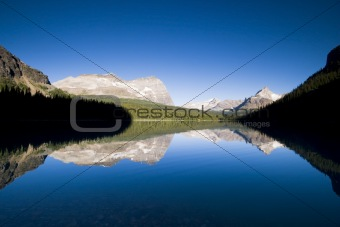 mountain range reflecting in lake