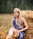 Young sexy woman among the straw.