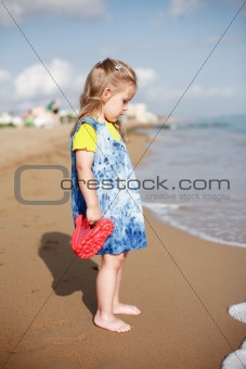 Small girl standing on beach