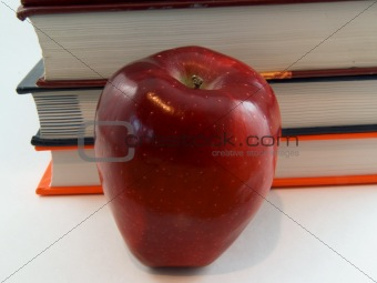 Apple in front of book