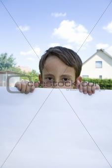 Boy keeps sheet of paper