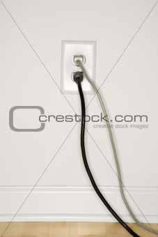 Wall outlet with plugs.