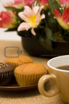 Cup cakes and a cup of coffee