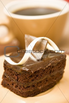 A sliced cake and coffee
